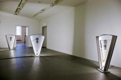Color Clocks: Verticals Lean Occasionally Consistently Away from Viewpoints, 2012, 3 Filmskulpturen, 35-mm-Film, Motoren, Neonlampen