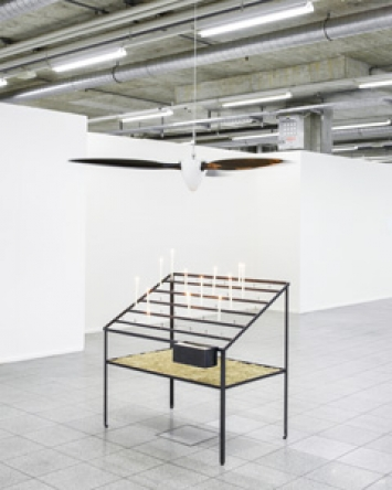 Devotional Power Bruliere with votive candles and propeller (1.8 × 1.2 × 2 m), 2011