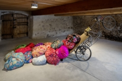 Kimsooja · Bottari Tricycle, 2008, Used Chinese tricycle, bedcovers and clothes, 200 x 170 x 300 cm