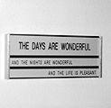 Vittorio Santoro · Schild (The Days are Wonderful), 1/3, 1999Aluminiumschild, 3 Kunststoffplaketten mit eingravierter Schrift, 16,5x18 cm; Courtesy Brandstetter & Wyss, Zürich