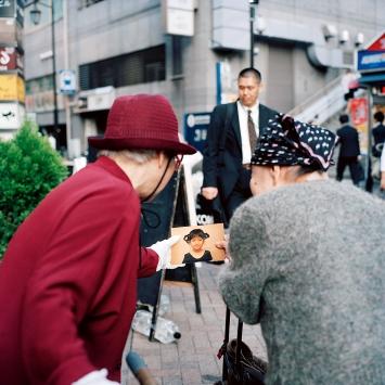 Shiba Minato (Two Women Holding Photograph), 2015